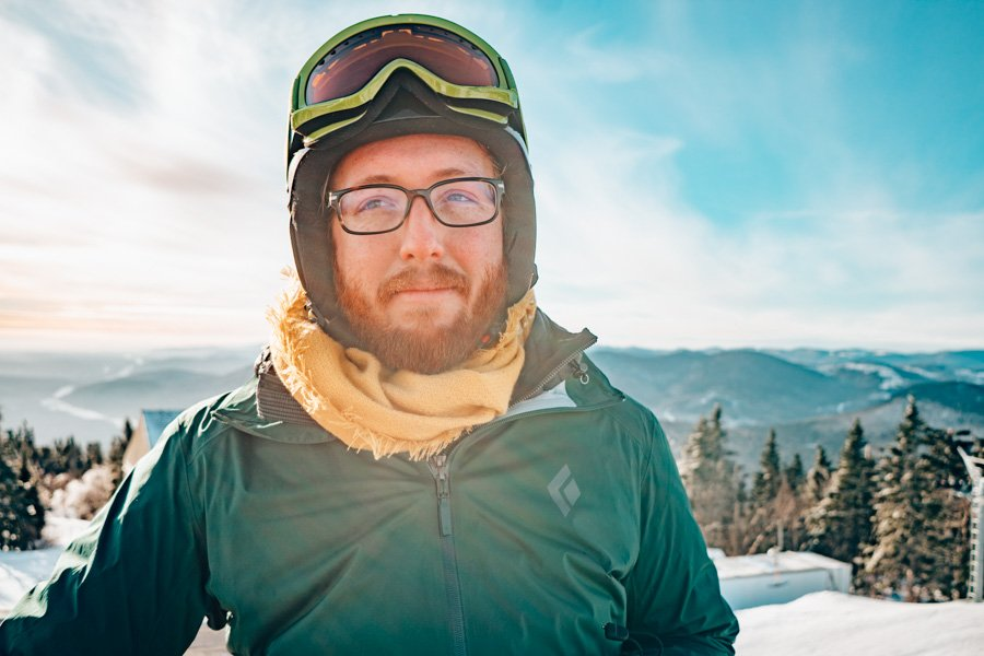 Jeremy, the snowboarding half of Practical Wanderlust, on the summit of Mont Sainte Anne near Quebec City, Canada.