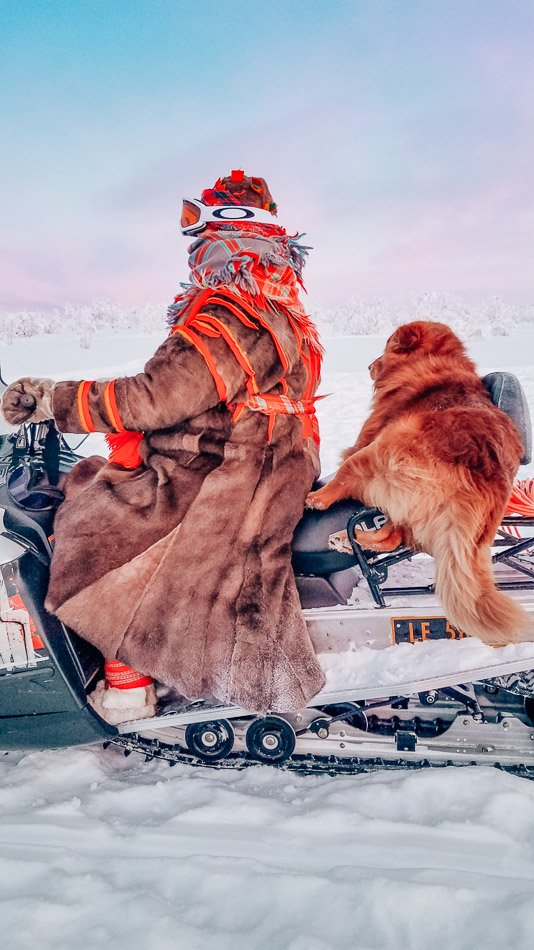 Our host, Oddbjørg, and her dog Barke driving a snowmobile and wearing the most fabulous and warm coat I have ever seen in my life.