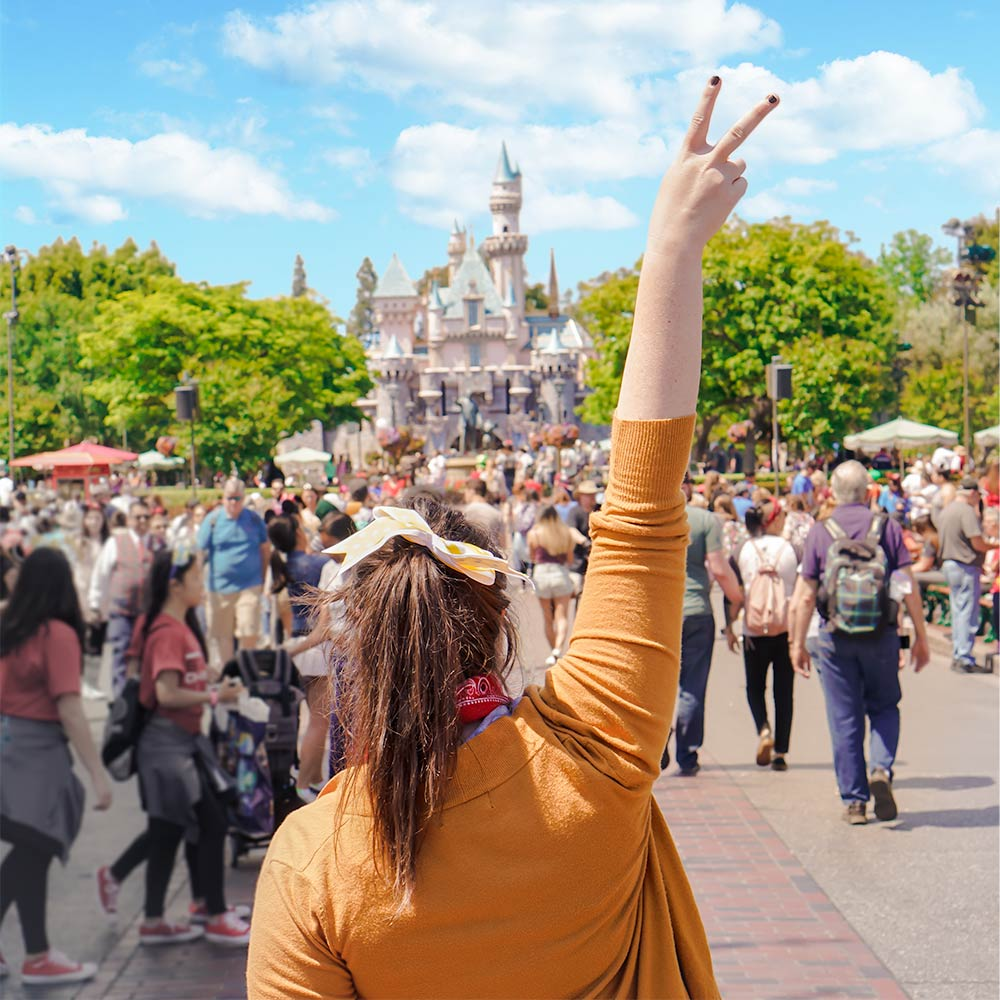 Peace sign in front of the castle at Disneyland in Anaheim, California.
