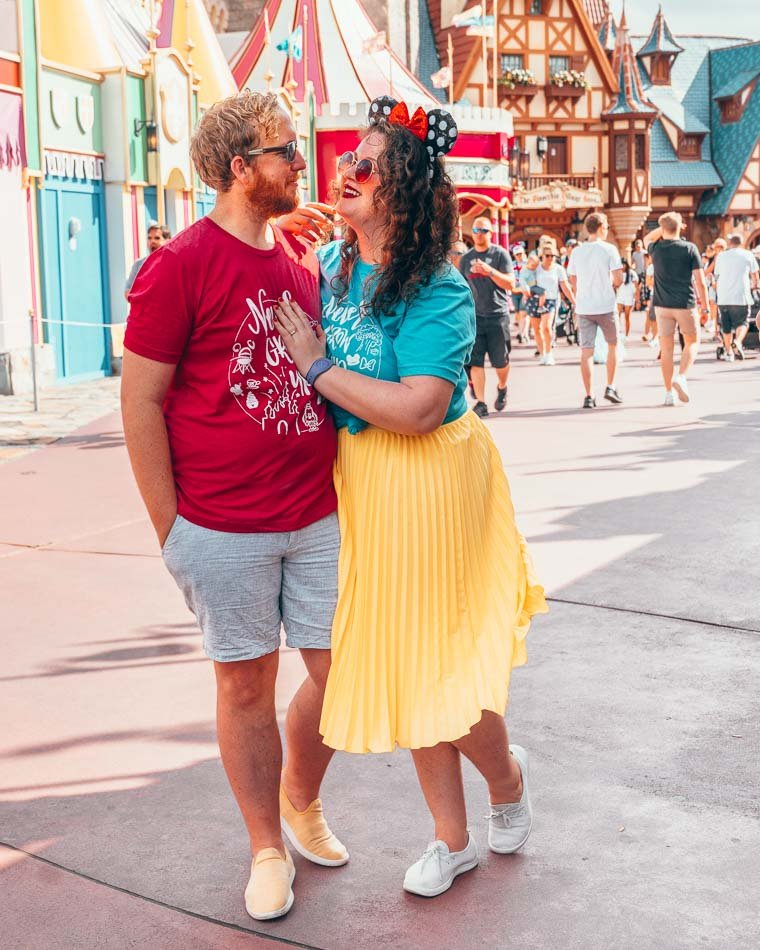 Couple wearing bright colors at Disney World in Orlando, Florida.
