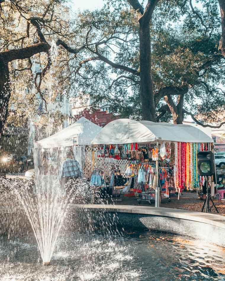 Fountain in front of an art fair in a shaded square in Savannah, Georgia