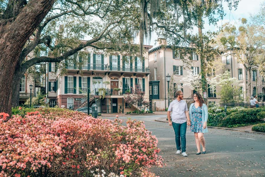 Lia and Jeremy among blooming flowers in Savannah, Georgia