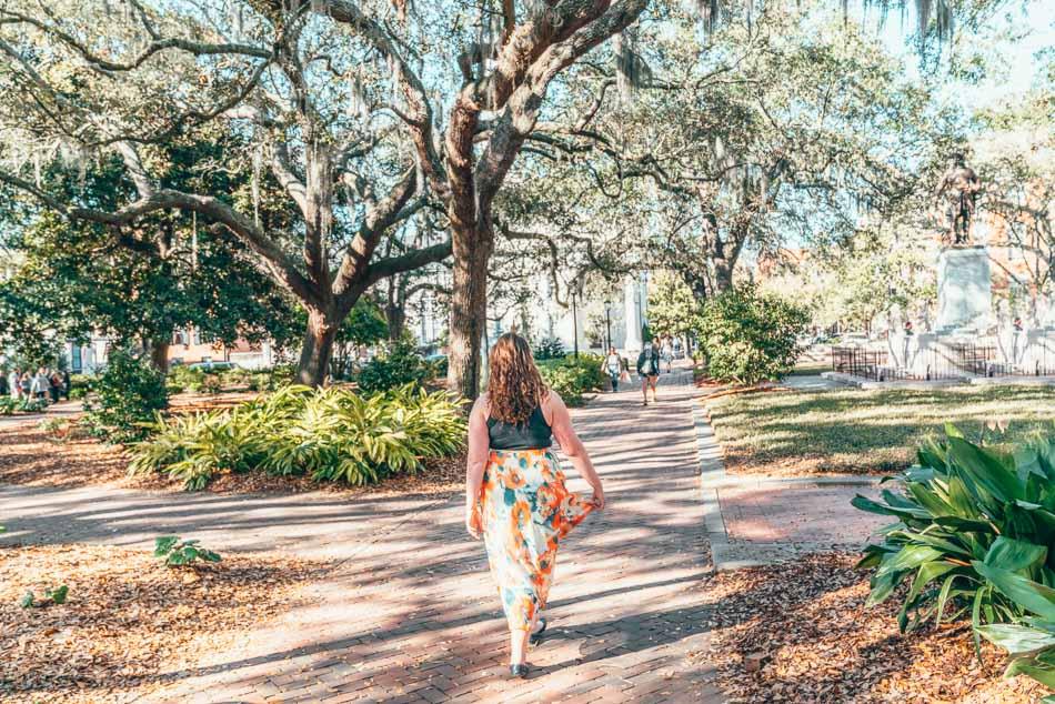 Girl exploring a sunny dappled square in Savannah, Georgia