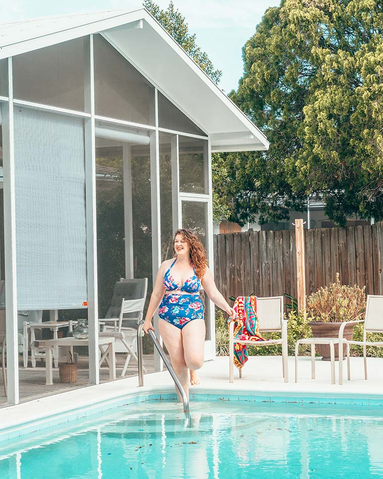 Curvy girl in a swimsuit at a pool