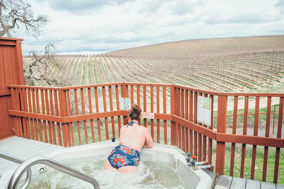 Soaking in a spring-fed hot tub at River Oaks overlooking vineyards in Paso Robles, California.