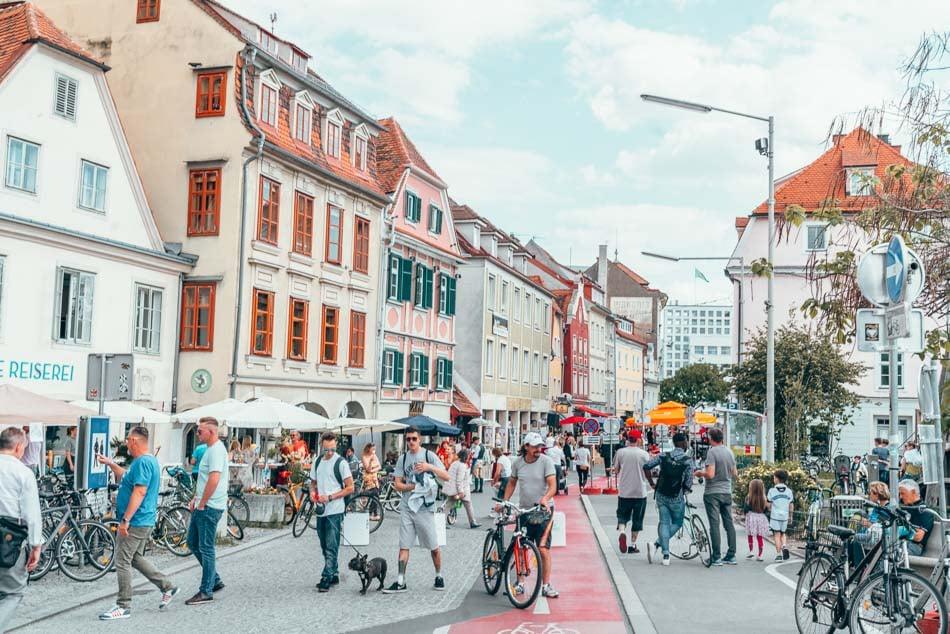 Everyone riding bikes in Old Town Graz, Austria.