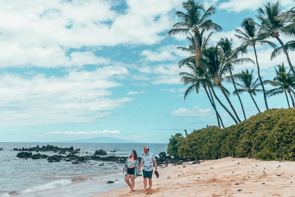 Lia & Jeremy on the beach in Maui, Hawaii on the perfect 3-day Maui Itinerary.