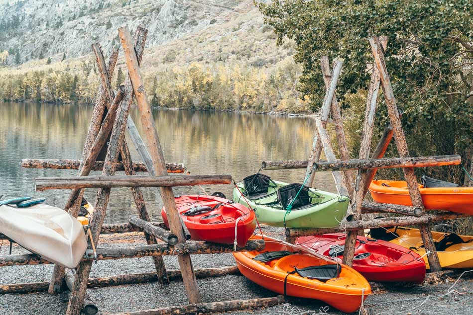 Kayaks reflected on the lake in Silver Lake California in the fall.