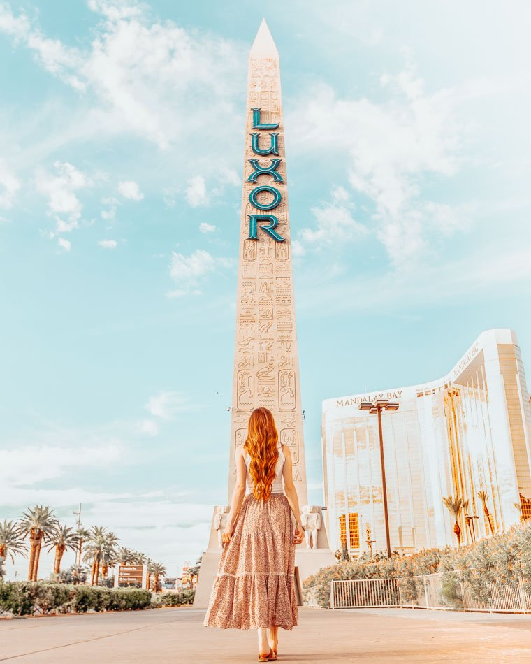 Girl standing infront of the Luxor Sign in Las Vegas.