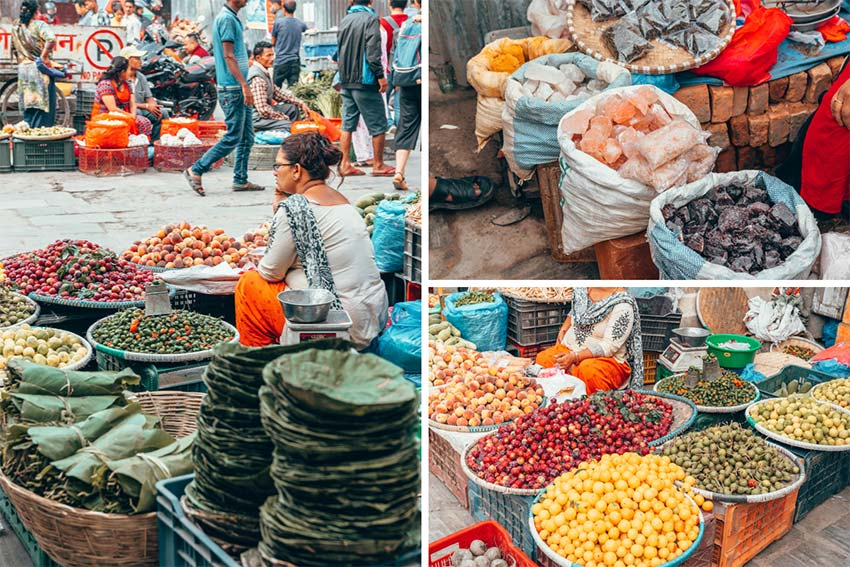 Street vendors in an outdoor market in Nepal selling fruits, veggies, spices, etc.