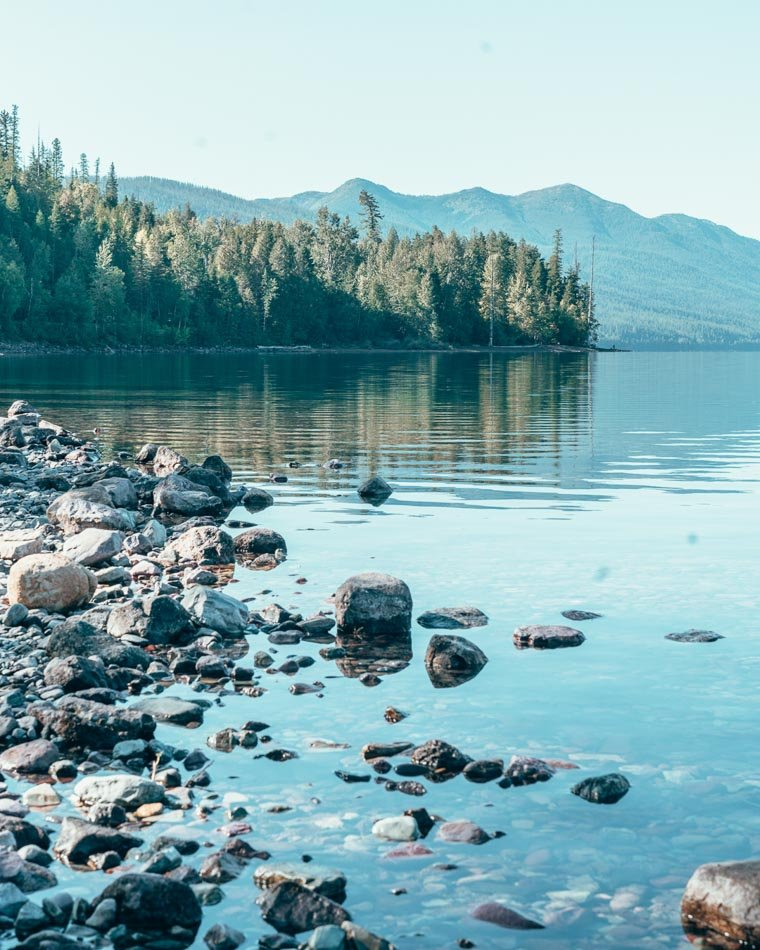 Crystal-clear water and colorful stones on one of the many glacial lakes in Glacier National Park, Montana.