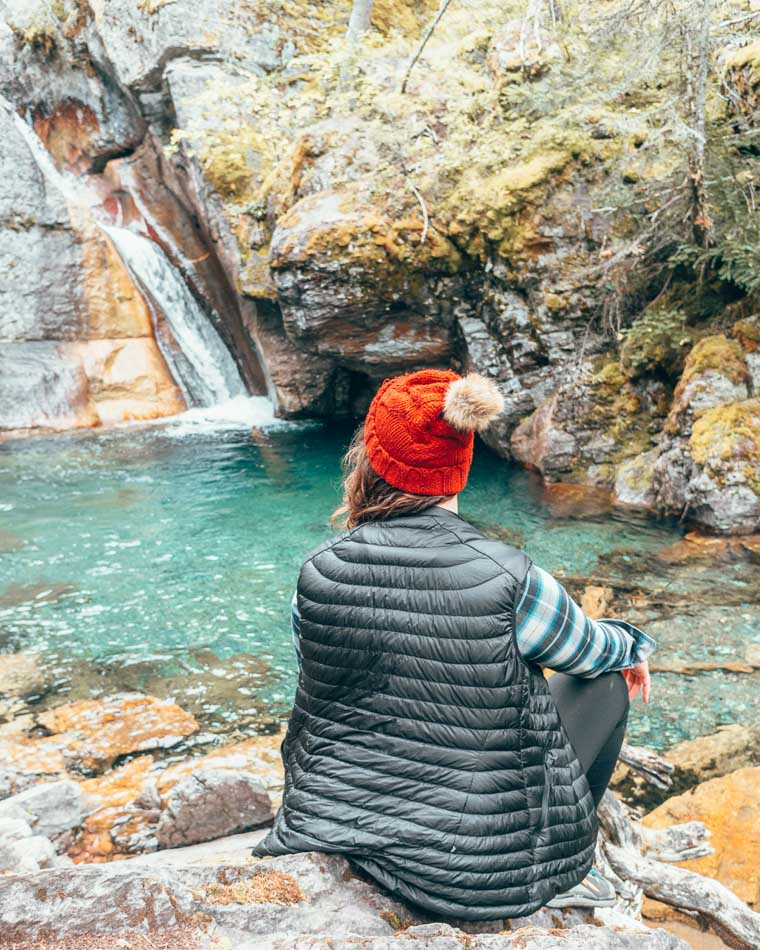 Girl looking at waterfall in Montana.