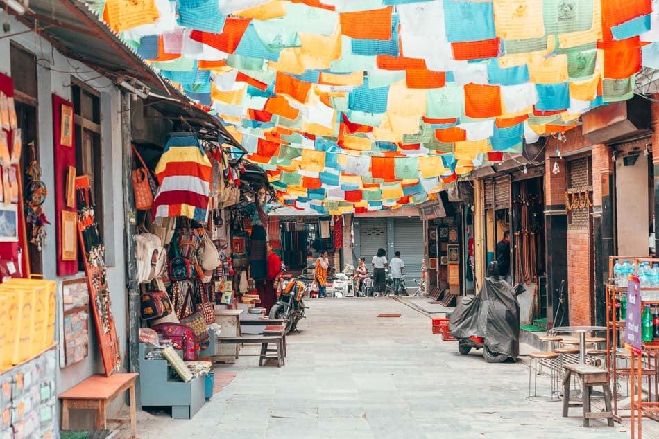 Prayer flag covered alley in Kathmandu, Nepal.