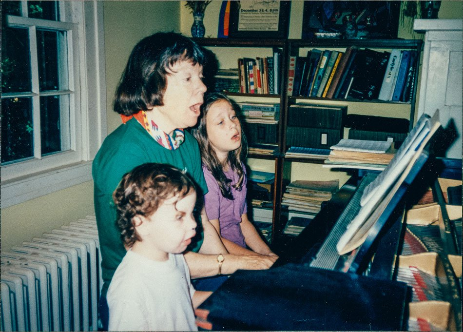 Katy playing piano and singing with my sister and me.