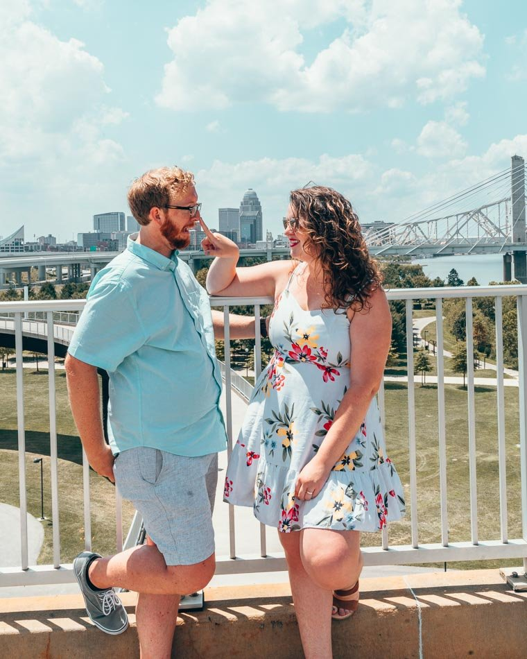 Lia and Jeremy being silly on the Big Four Bridge in downtown Louisville, Kentucky. Walking the Big Four Bridge is one of the best things to do in Louisville KY.