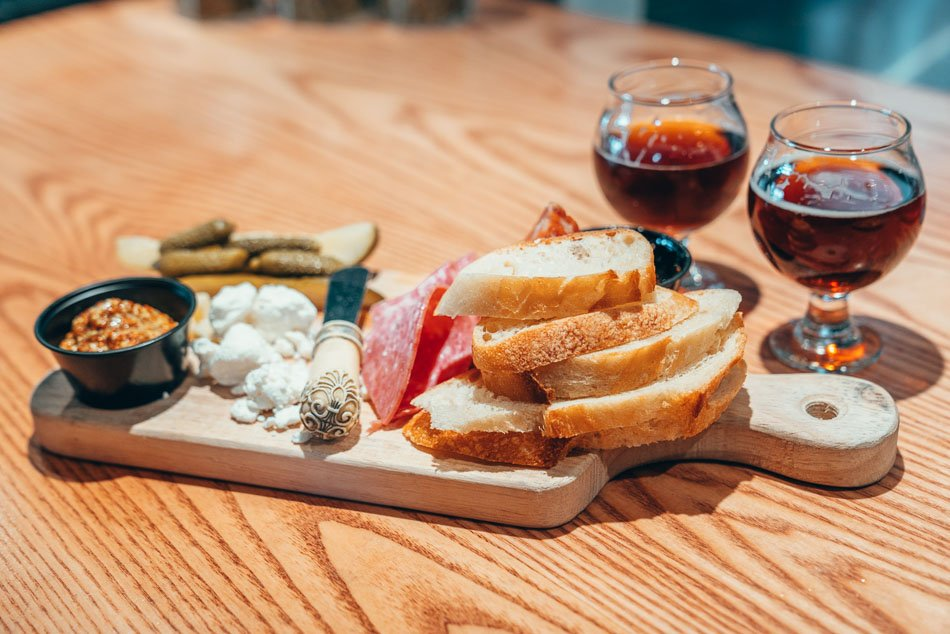 Charcuterie board at Level Crossing, one of the best Salt Lake City breweries.