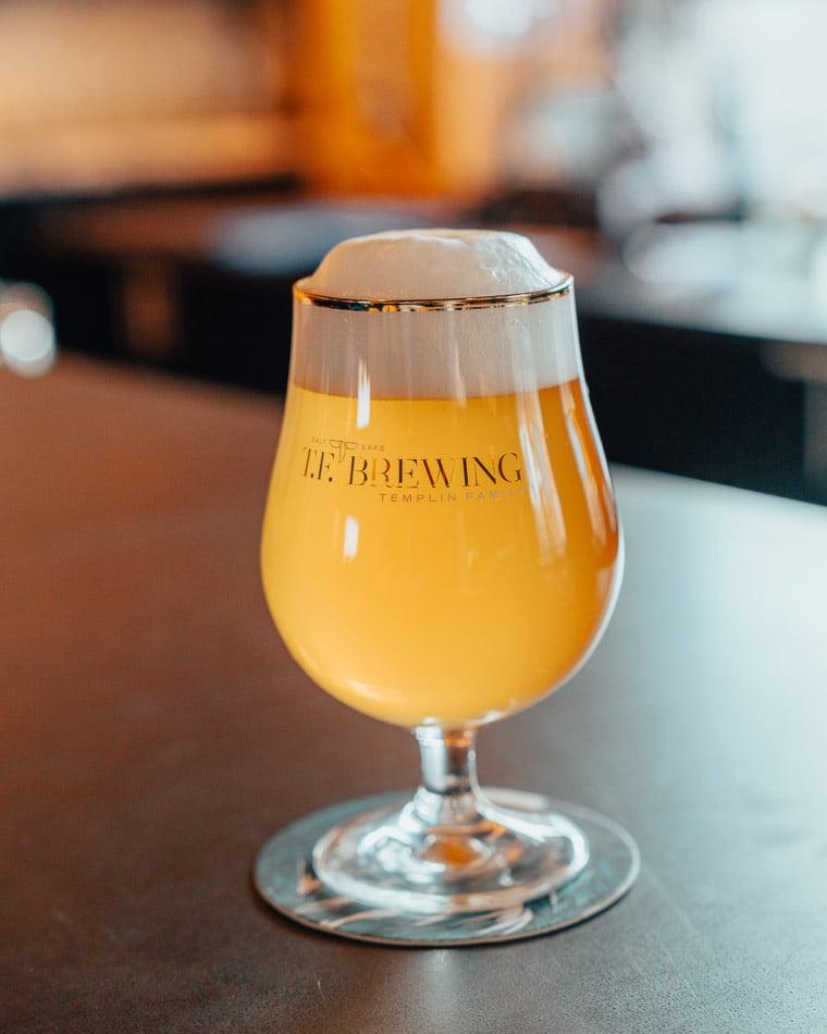 Foamy beer at TC Brewing in Salt Lake City, Utah, one of the best breweries in Salt Lake City.