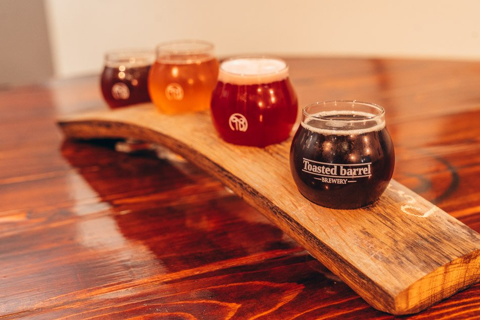 Barrel aged and sour beer tasting flight at Toasted Barrel, one of the best Salt Lake City breweries.