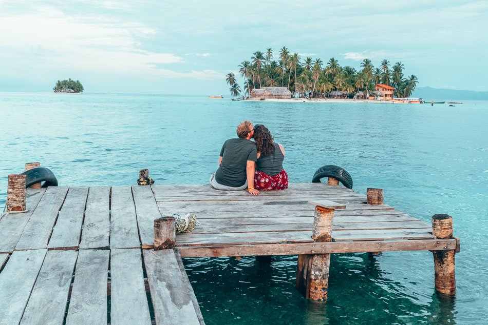 Couple on a dock in San Blas, Panama.