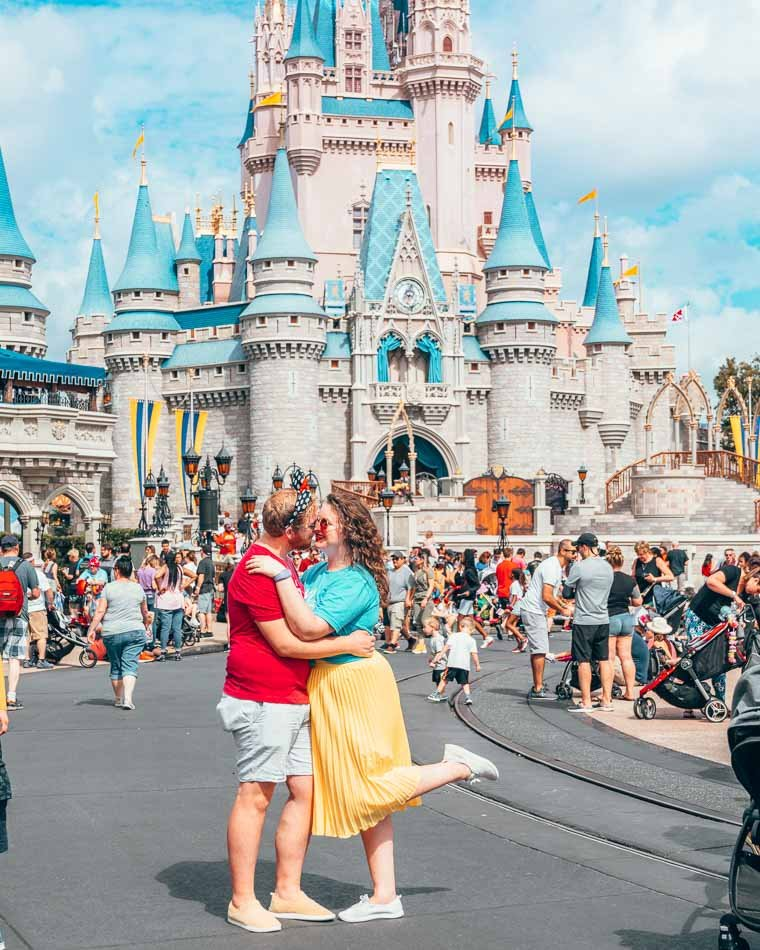 Kissing in front of Cinderella's Castle at Disney World in Orlando, Florida.