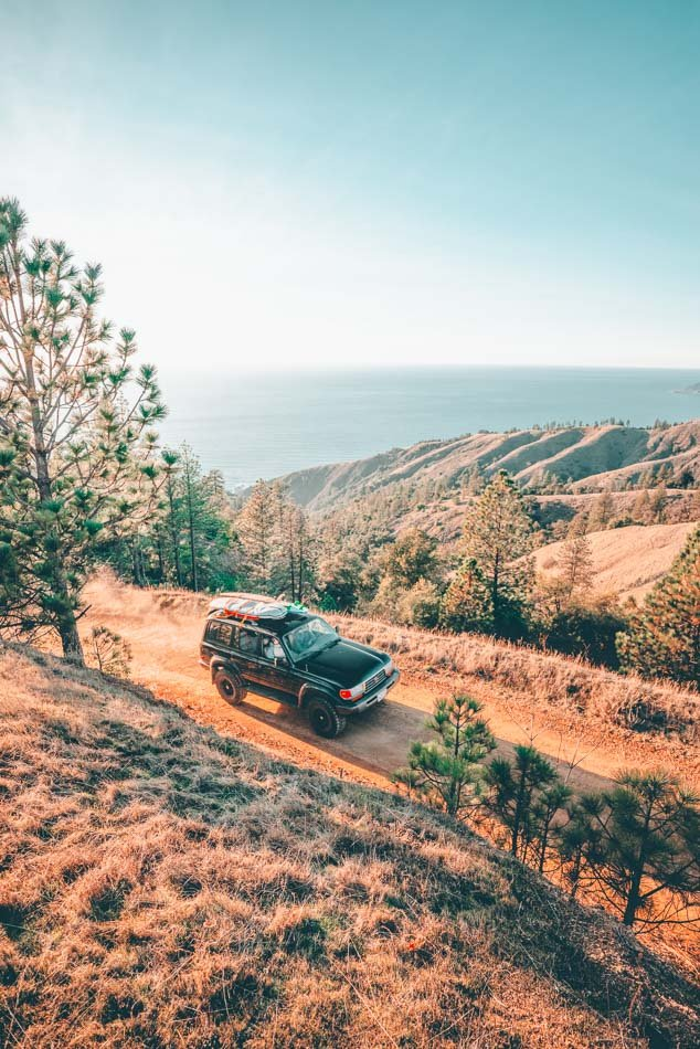 Driving on a road overlooking the California coastline