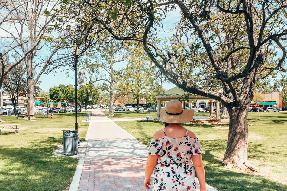 Strolling along the central plaza in Paso Robles, California.