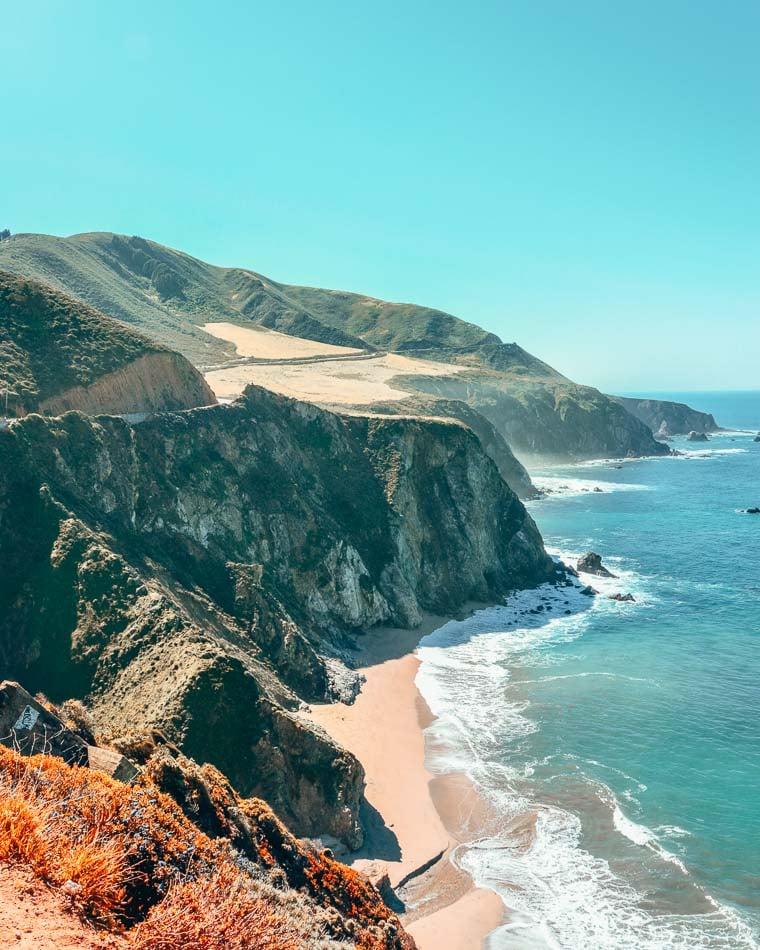 Cliffs descending into the ocean along the California Coast on the Pacific Coast Highway.