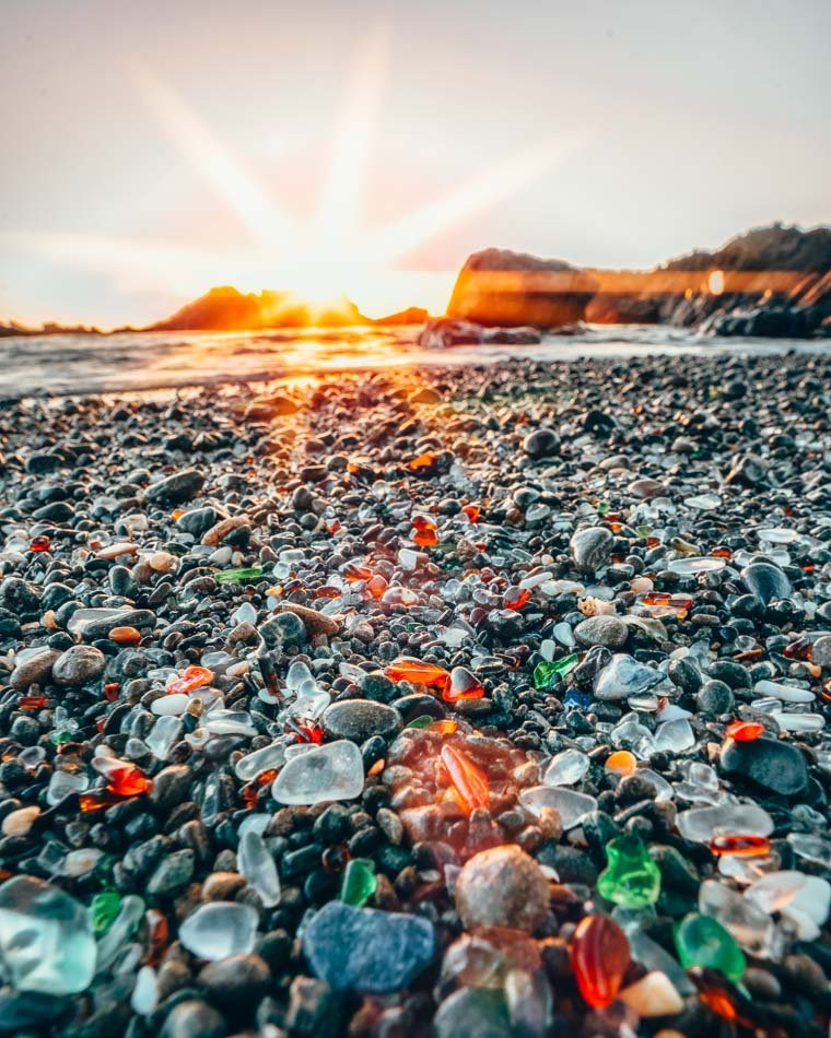 Colorful sand on Glass Beach at sunset in Fort Bragg, California.