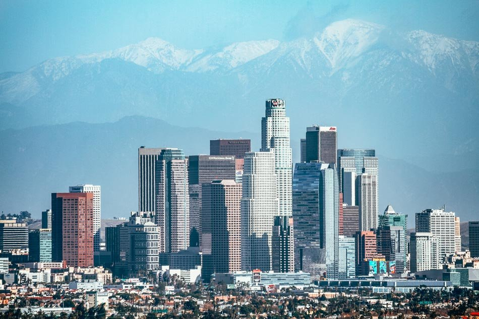 The snow-covered peak of Mount Baldy rising above the Los Angeles Skyline in Southern California