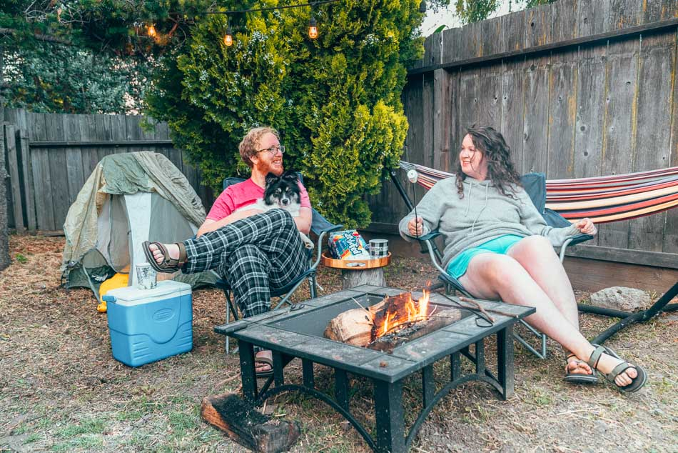 Backyard camping around a firepit.