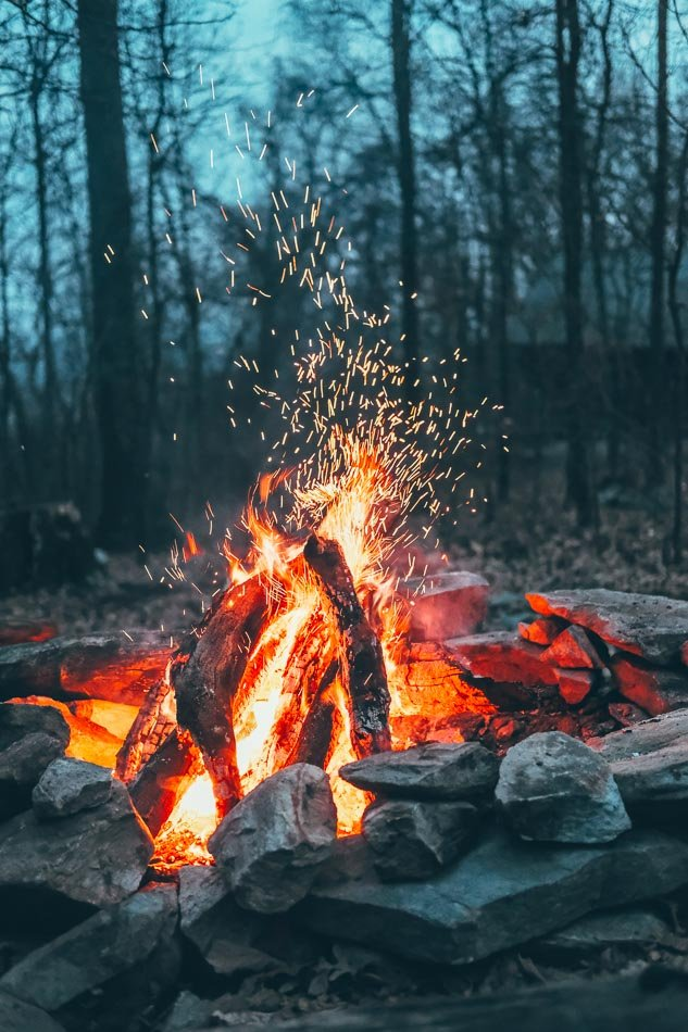 Roaring campfire on a summer camping trip.