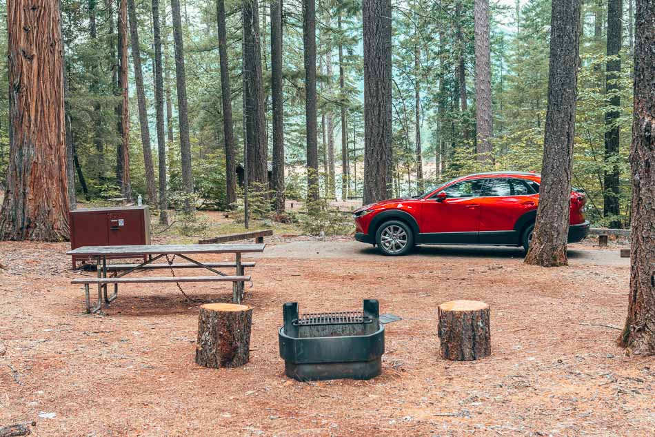 Candy-apple red 2020 Mazda CX-30 at a campsite in the Trinity Alps Wilderness, Northern California.