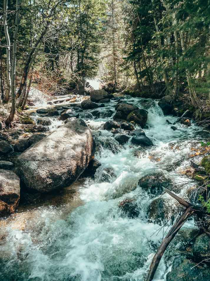 Waterfall running through Bell's Canyon, near Little Cottonwood Canyon, outside of Salt Lake City, UT. One of the best hikes in Salt Lake City.