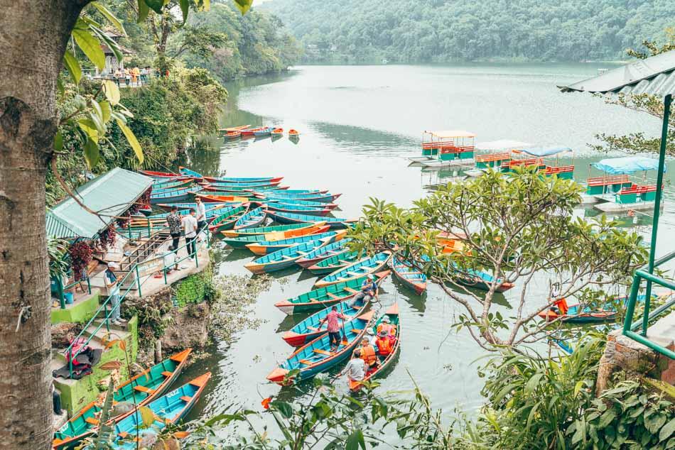 Colorful boats docked on Phewa Lake in Pokhara, Nepal