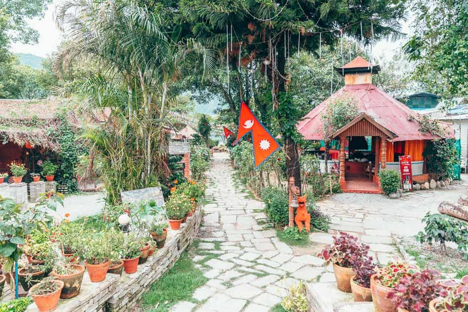Garden path leading to Phewa Lake in Pokhara, Nepal