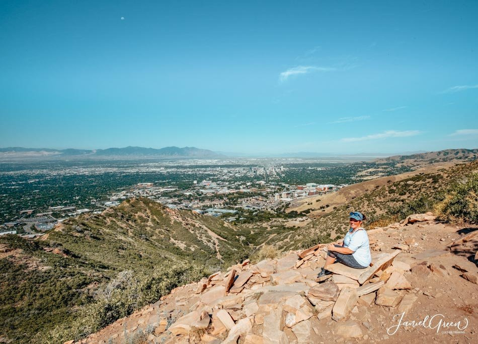 Girl sitting at the top of The Living Room Lookout Trail in Utah, USA.