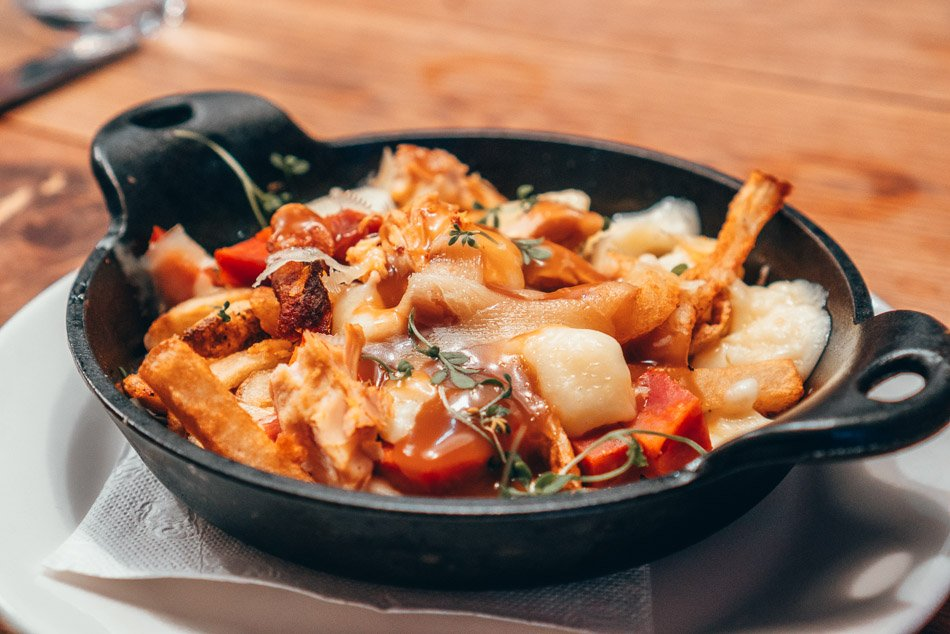 Poutine from La Taberna in Montreal, made with roast chicken and chorizo!