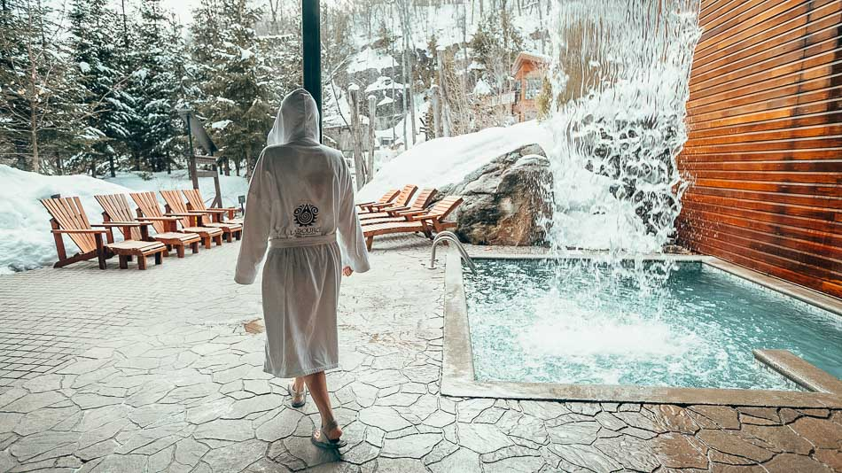 Woman walking through a Nordic Spa in Canada.