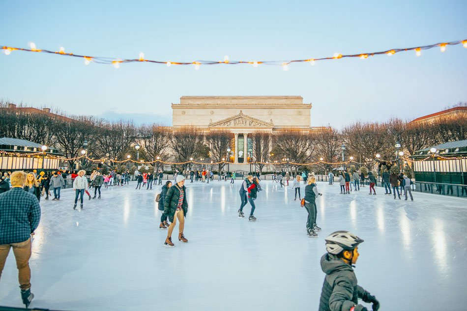 People in ice rink at the National Gallery of Art in the Sculpture Garden.