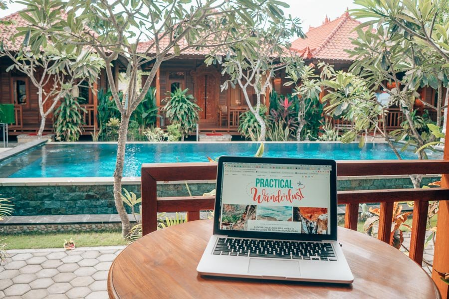 Laptop in front of a pool in Bali, Indonesia.