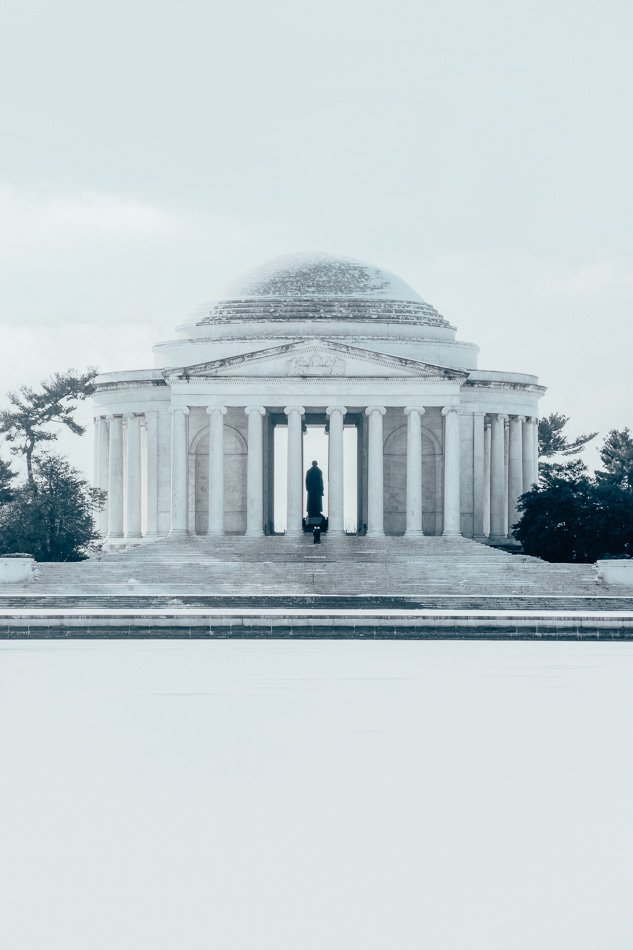 The Jefferson Memorial in front of a frozen tidal basin on a winter day.