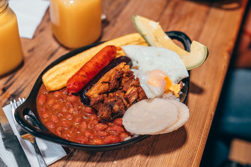 Bandeja Paisa platter with arepas, one of the most iconic Colombian dishes!
