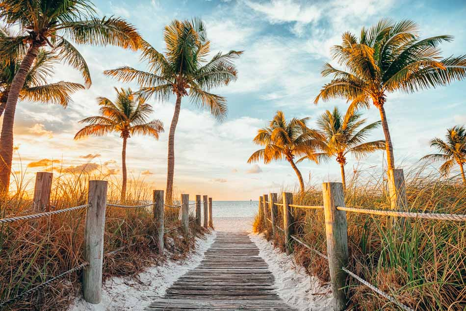 Footbridge to the Smathers beach at sunrise in Key West, Florida.