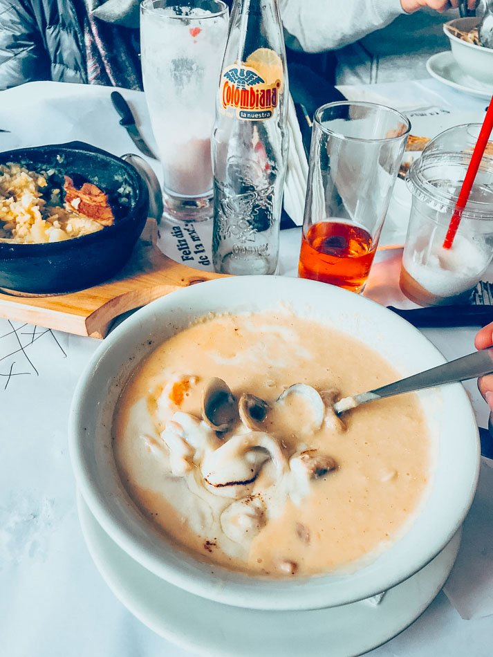 Cazuela de Mariscos is a creamy seafood stew that is cooked with coconut milk and shrimps, clams, and white fish.