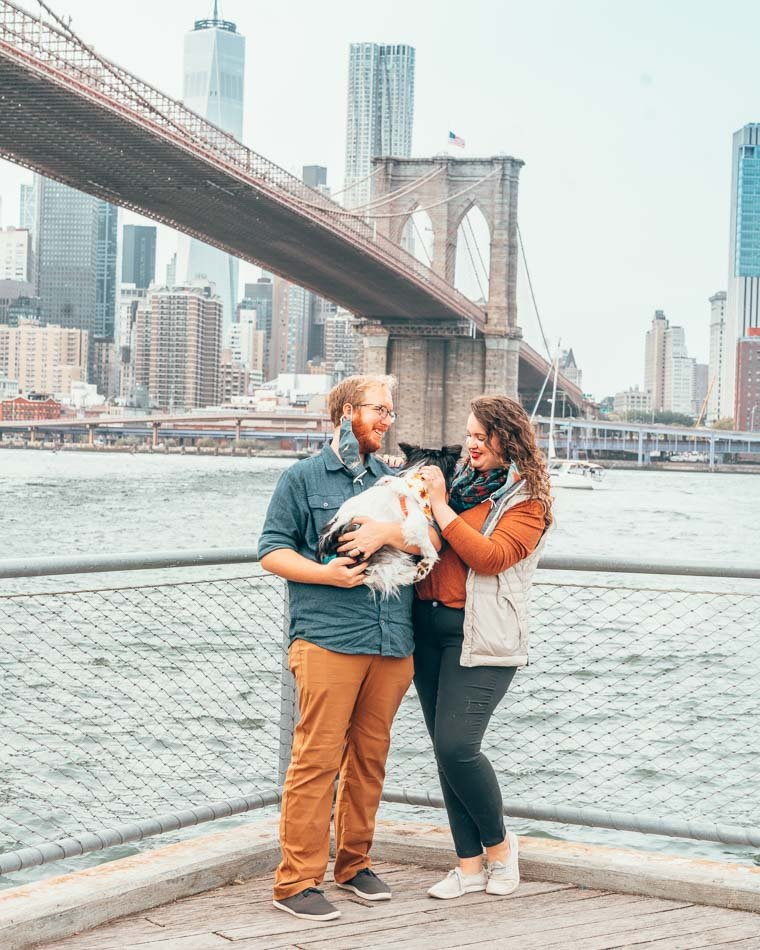 Couple and Dog in DUMBO at Brooklyn Bridge in New York City wearing masks