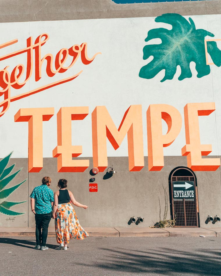 Couple in front of mural in Tempe, Arizona