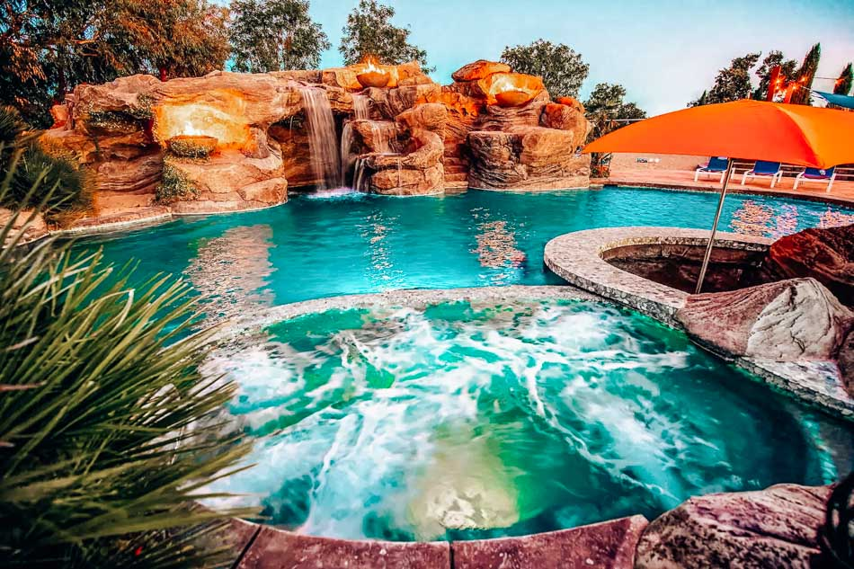Waterfall pool at the Mermaid Mansion, one of the best Paso Robles Airbnbs to book for groups!