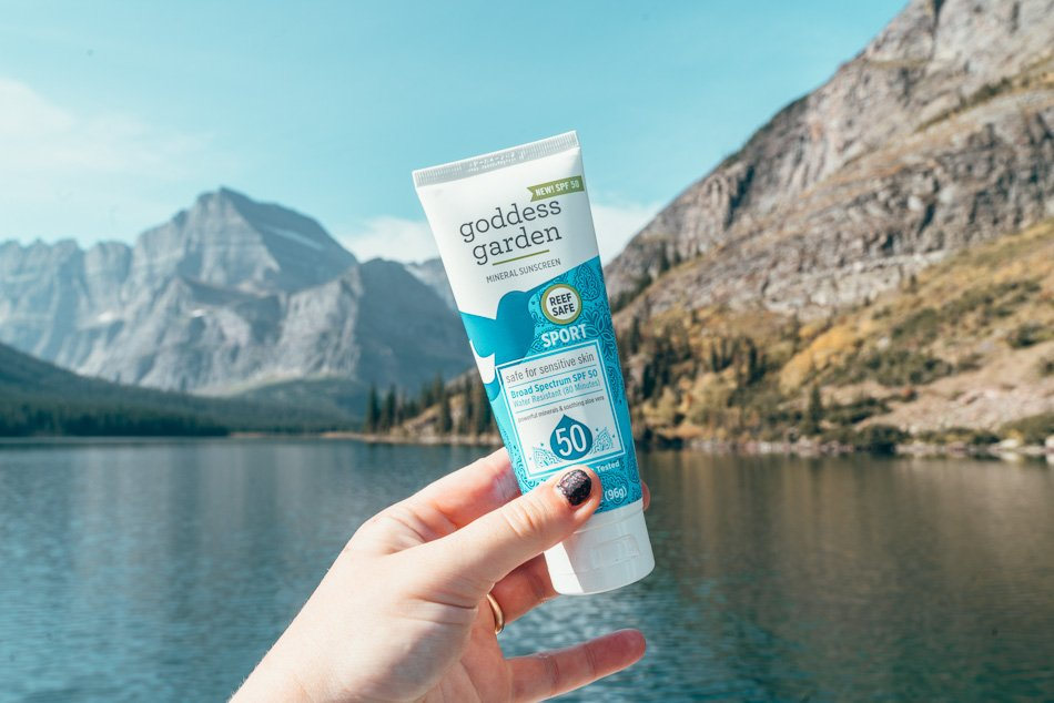 Goddess Garden Mineral Sunscreen in front of a lake in Montana.