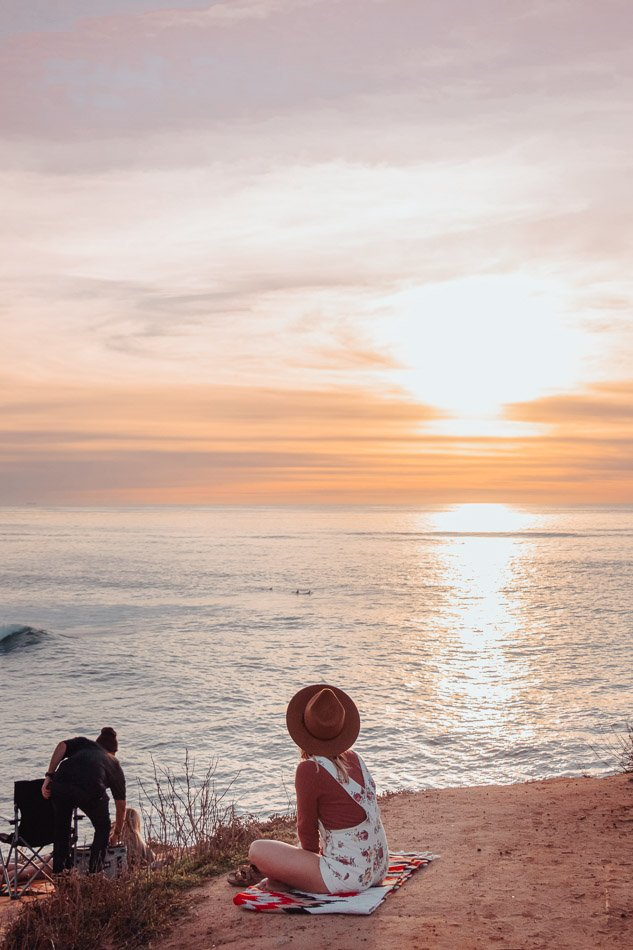 A girl watching the sunset at Sunset Cliffs in San Diego, CA - Unsplash