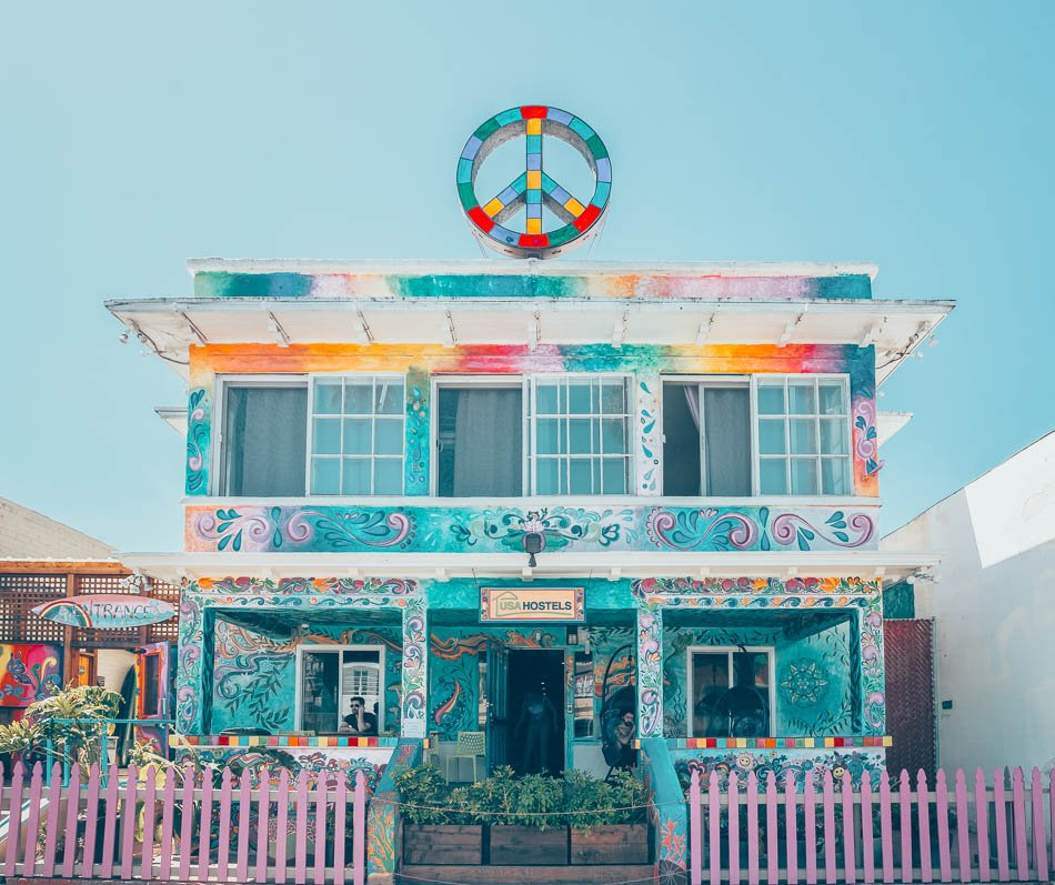 A peace sign on top of a hippy themed colorful hostel in San Diego, CA.